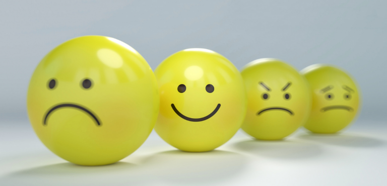 yellow faces with happy, sad, angry, anxious expressions. Autism and anxiety