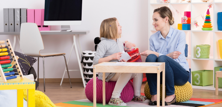 What next autism diagnosis child sitting with professional